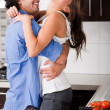 Royalty-Free Stock Photo: Playful couple in kitchen