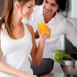 Couple in the kitchen with juice — Stock Photo