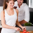 Happy young couple in the kitchen — Stockfoto #1148156