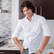 Portrait of happy man in the kitchen — Stock Photo #1148173