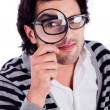 Man looking with a magnifying glass — Stock Photo #1148226