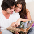 Cute couple looking photos — Stock Photo