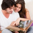 Cute couple looking photos — Stock Photo #1148359