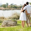 Rear view couple holding each other — Stock Photo