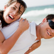 Couple smiling on the beach — Stock Photo
