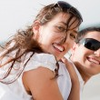 Couple look back and smiling — Stock Photo
