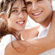 Young couple embracing each other - Stock Photo