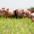 Young couple relaxing on a lawn — Stock Photo