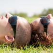 Royalty-Free Stock Photo: Couples laying on a lawn and looks sky