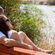 Couple sitting at the wooden bench — Stock Photo