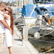 Happy couple hugging in harbour — Stock Photo