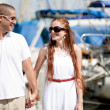 Couple holding their hands in harbor — Stock Photo #1149134