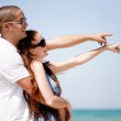 Couple hold each other and pointing sky — Stock Photo