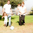 Parents and kids playing football — Photo