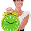 Business woman with green clock - Stok fotoğraf