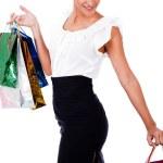 Woman carrying shopping bags — Stock Photo #1149506