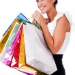 Women smiling with shopping bags — Stock Photo