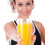Woman holding fresh juice — Stock Photo