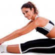 Woman in fitness outfits stretching — Stock Photo
