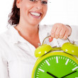 Young happy woman carrying a clock — Stock Photo