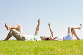 Couple lie down on grass — Stock Photo