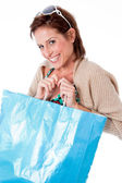 Women smiling with shopping bag — Stock Photo