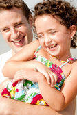 Kid and father smiling in the beach — Stock Photo
