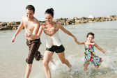 Family in the beach — Stock Photo