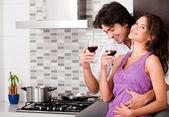 Couple drinking wine in kitchen — Stock Photo
