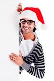 Santa pointing down at blank billboard — Stock Photo