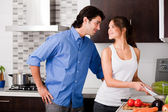 Young couple in the kitchen — Stok fotoğraf