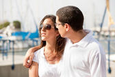 Young happy couple at the harbor — Stock Photo