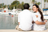 Couple sitting at the harbor — Stock Photo
