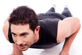 Man working out with push ups — Stock Photo