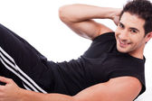 Man doing Abdomen exercise — Stock Photo