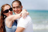 Loving couple together at the beach — Stock Photo