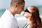 Young romantic couple about to kiss — Stock Photo