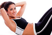 Woman doing Abdomen exercise — Stockfoto