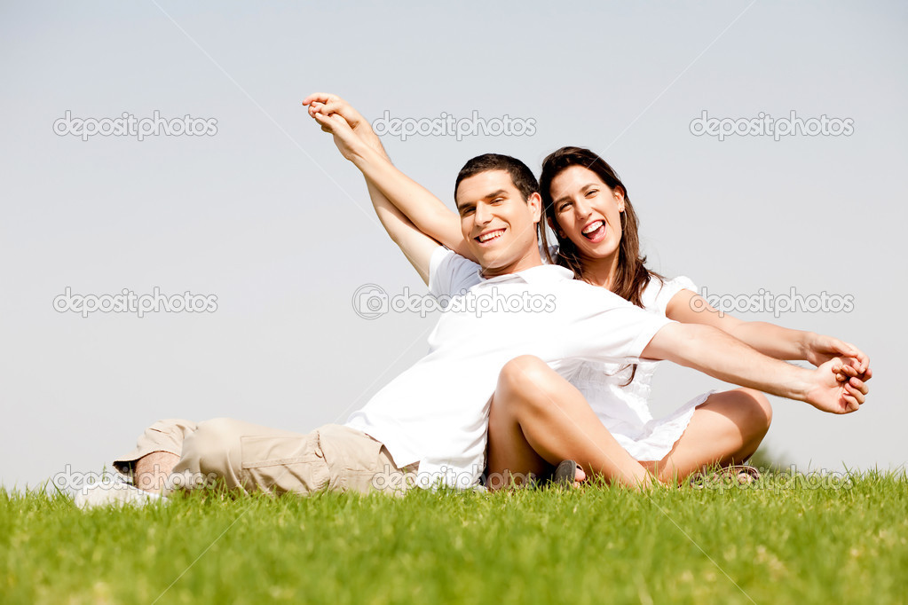 Cute young couple in a hands outstretched  Stock Photo #1142388