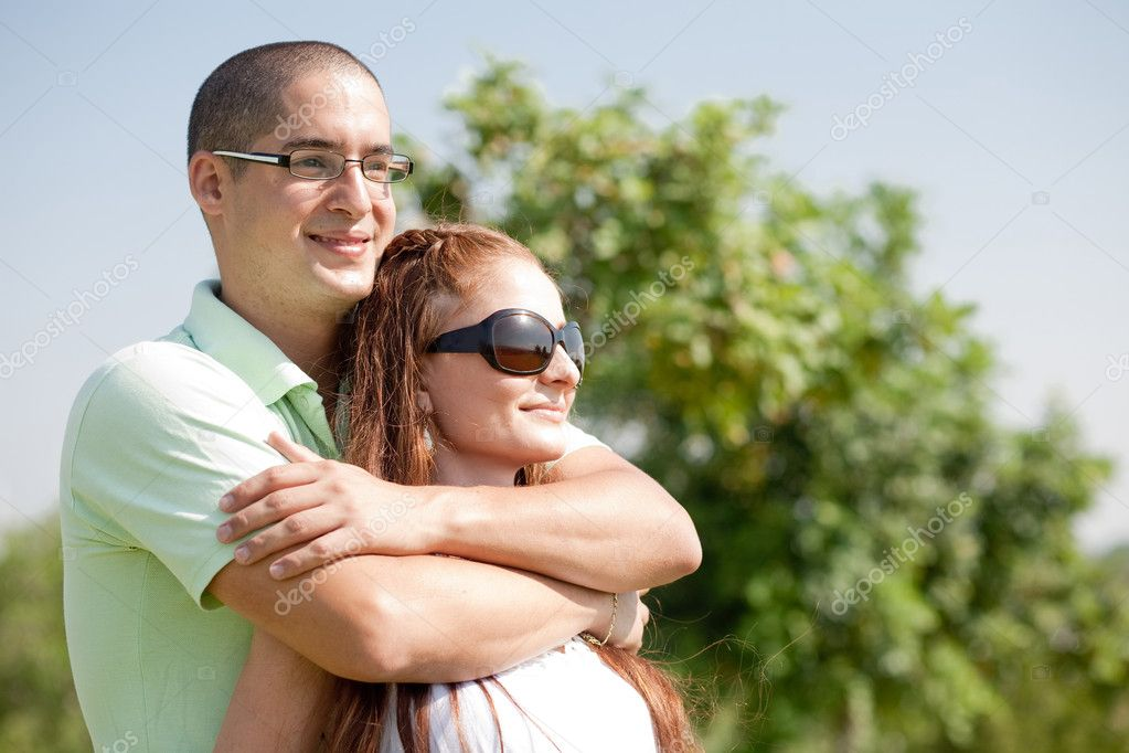 Happy young couple hug,park outdoor — Stock Photo #1144388