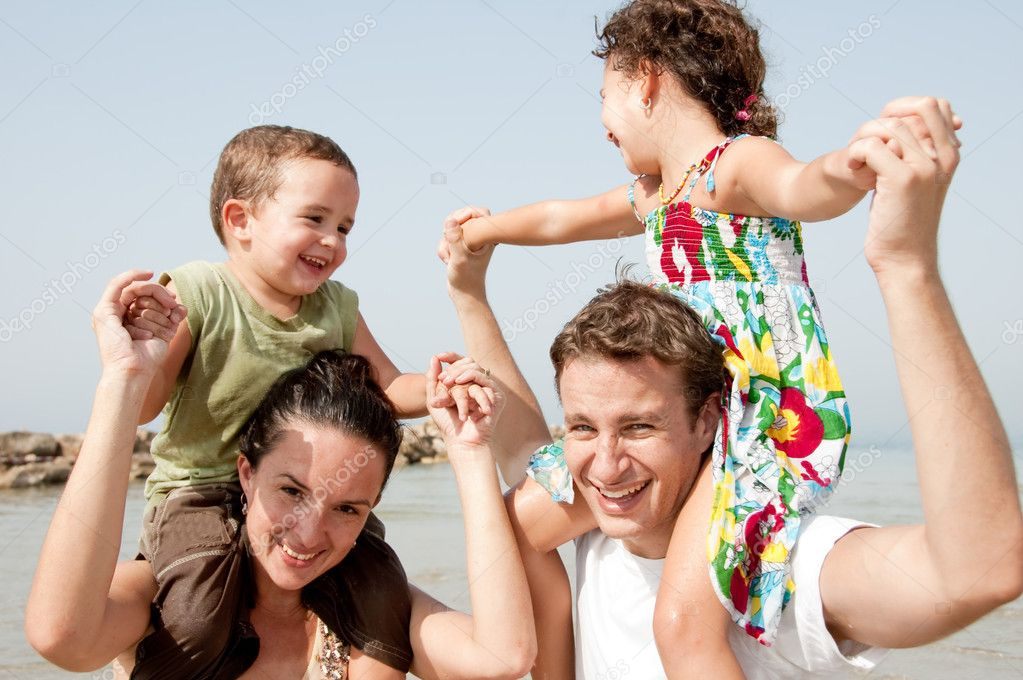 Parents with children sitting on the shoulders — Stock Photo #1147522