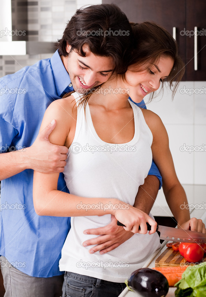 Romantic young couple enjoying their love in kitchen — Stock Photo #1148086
