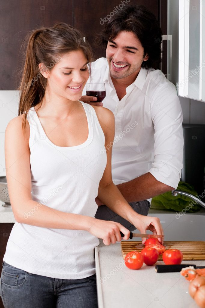 Happy young couple in love at the kitchen  Stock Photo #1148156