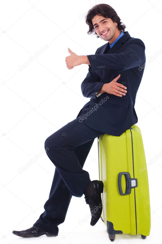 Corporate man sitting above the luggage showing thumbsup in isolated white background — Foto Stock #1148177
