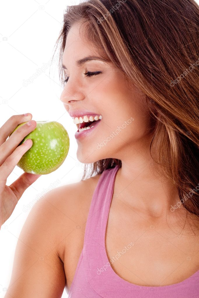 Closeup of happy young girl ready to bite a green apple  Stock Photo #1148275