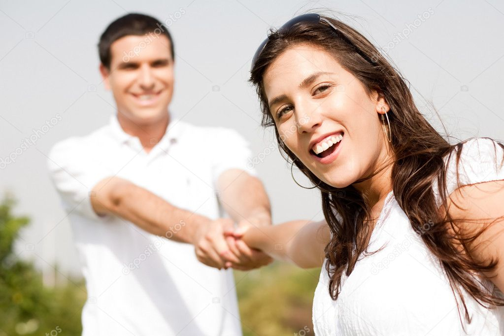 Happy young couple in playful mood focus on woman in outdoors — Stock Photo #1148476