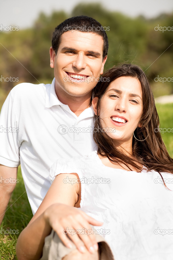 Portrait of Happy young couple sitting and smiling in the park  Stock Photo #1148510