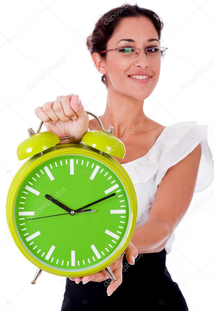 Young business woman showing a green color clock on isolated white background — Stock Photo #1149503