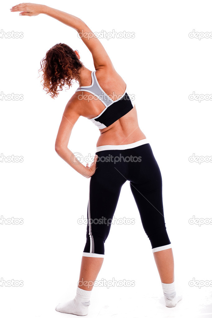 Rear view of a Cute fitness girl stretching her body on isolated white background — Stock Photo #1149587