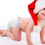 Baby crawling with santa cap — Stock Photo #1244374